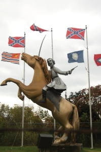 Crazy Nattie Forrest and his Confederate cavalry are going to slay yo' negro asses. Still, it's one thing to erect a monument dedicated to a guy who's tied to a shitload of racial injustice (he was a slave trader before the war). It's another to depict him as a raging angry white man in a silver cast with pistol in one hand and sword in the other. And he looks like a homicidal maniac out for blood.