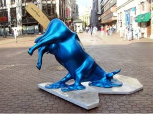 Maybe this shiny blue cow was a victim of some kind of cow tipping and just wasn't able to get back on its feet.