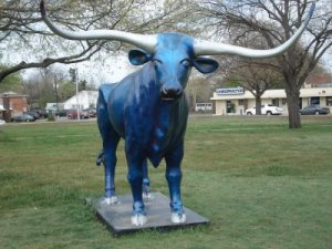 His long horns represent his great virility and his ability to kick your ass when pissed. His blue complexion represents his fondness for pasture shrooms.