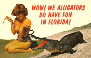 Either this is an interspecies romance resulting in Governor Rick Scott or the bathing beauty is going to be dinner.