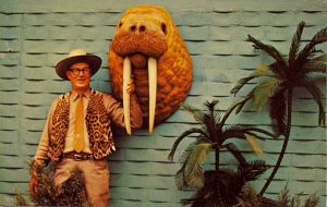 Seriously, that leopard vest is hideous. Also, I wouldn't mind if this guy would be mauled by elephants on his next trip.