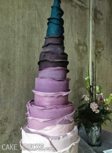 Of course, the baker got so carried away with the cake design that the wedding has gone way over budget.