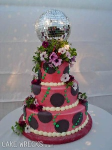 Of course, this cake design brings us why people no longer look to the 1970s for decorating ideas. Also, a disco ball as a cake topper? That's tacky beyond all understanding.