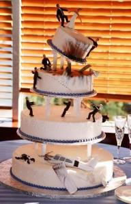 I don't know about you but this wedding cake contains all sorts of things that no wedding cake should have. I mean its supposed to be a happy occasion, not set to the scene of some action movie with plane crashes, gunfights, and blood everywhere.