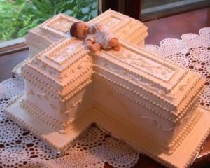 Wait a minute, is this for a baby shower or a baby funeral? Seriously, that cross kind of makes it disturbing. Of course, in Rick Bobby's opinion, this is a cake of Baby Jesus.