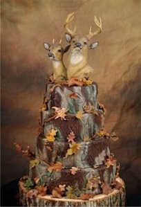 I don't know about you but I think deer heads should be on someone's wall, not on a wedding cake. It's kind of tacky if you ask me but at least the rest of it is tasteful.