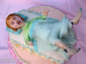 Hey, at least they didn't depict a cake with a c-section. Still, why have a cake depicting this? Why? I mean she has bloodshot eyes, for God's sake.