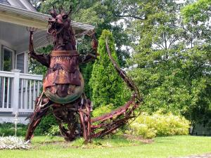Yet, let it be known that this lawn statue isn't going to help you get along with the neighbors or receive an invitation to the neighborhood cookout. In fact, this may make your neighbors afraid of you.