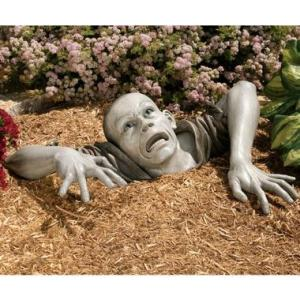 For a zombie garden sculpture, this looks astonishingly lifelike that it's kind of creepy. In a kitcshy sort of way that is.