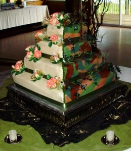 As awful looking as this cake is, at least both bride and groom tried to accommodate their tastes. Still, camouflage shouldn't be used on wedding cakes. I'm sorry.