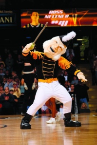 Let's see, who's idea for a college mascot consisted of a crusty mutton chop old guy in 19th century naval attire? This guy is simply terrifying, especially since he's holding a big stick he intends to whack any player who doesn't play to his specifications.