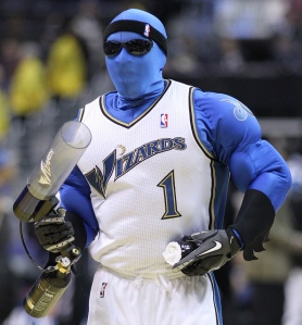 Good News: Well, at least he's not as bad as the G-Wiz mascot from earlier. Bad News: Looks as if he was a former member of Blue Man Group who was thrown out for steroid use.