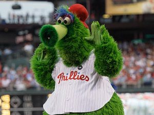 I guess since he landed on planet earth,as well as appreciating it much more than wherever he came from, the Phillie Phanatic signed to be a mascot for the Phillies. Either that, or his Philadelphia mascot gig is a backup line of work after he fail his audition for Sesame Street. We're not sure which.