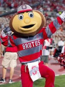 "Now hearing the name of ""Brutus Buckeye"" you'd think that Ohio State's mascot could be a rather fearsome mascot. Alas, this dopey guy with a nut head doesn't even live up to his rather awesome name. And as far as dumb mascots go, he appears on every list compiled by those who don't live in Columbus or attended OSU."