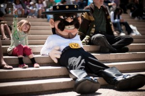 """This mascot reminds me of something I heard from The Treasure of the Sierra Madre. Something that goes along with: """"Badges? We ain't got no badges. We don't need no badges! I don't have to show you any stinkin' badges!"""" Yeah, kind of a negative Hispanic stereotype here."""