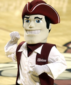 """Though the Minutemen is a good nickname for UMass, Sam seems to smile like a corrupt colonial politician than as an embodiment of patriotism. More like, """"vote for me or I'll steal this baby's lollipop"""" than anything."""