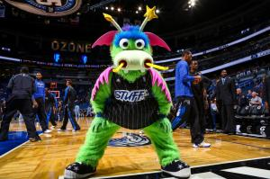 """Stuff the Magic Dragon is: A. Designed by a 5 year old or by some guy on acid who was a fan of Peter, Paul, and Mary. B. Originally going to be called """"Puff the Magic Dragon,"""" but the Orlando Magic was sued by the 1960s folk trio for copyright infringement. C. An alien from outer space. D. A muppet character reject from Sesame Street. Or E. All of the above."""
