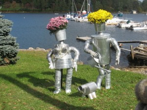 Yes, they have flowers on their heads. Yes, that's a dog made out of cans. And yes, Mrs. Tinman's breasts are cone shaped. Still, it's just a scarecrow display, man.