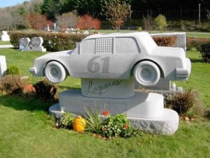 Well, I got to say that this is the most expensive tombstone for a race car buff I've ever seen. Of course, this grave might belong to a race car driver which is more understandable.