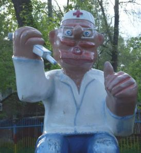 Now why in the hell would anyone have a playground figure like this? I mean there are adults terrified of needles, let alone kids. Horrifying indeed.