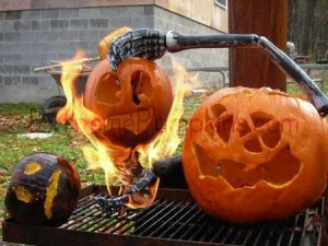 Okay, that's a little too disturbing and very unsafe. I mean this pumpkin is just vile taking over the grill burning his smaller counterparts. Sheesh.