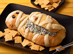 Now this isn't really scary but there's a curse for those who partake of this creamy spinach and artichoke dip from Pharaoh Askenaten's tomb.