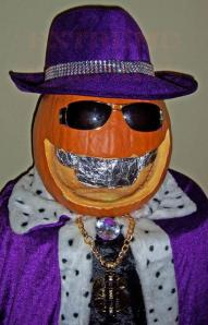 Now this is just in really poor taste. Seriously, pimps are never good idea for Halloween costumes or pumpkins, especially if you have black people in your neighborhood.