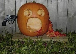 Now this is just simply inappropriate and certain to offend neighbors. Using a gun in a Halloween display is never okay. Seriously, gun violence is nothing to joke about at all.
