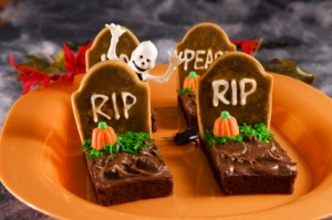 Guess Halloween is the time of year where you can make any plot of brownie treats into a grave yard. Doesn't scare me enough to eat them.