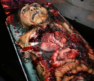 Makes a lot of the cakes in my baby shower cake post seem less gruesome in comparison. And if it weren't for the cartoonish face, I would've thought it came from the morgue.