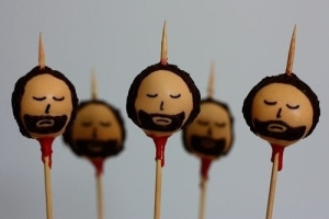 Now I know these aren't real severed heads. Yet, who's sick and twisted idea was it to make treats with impaled heads?