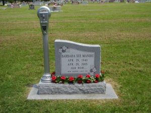 Of course, if you stay at this woman's grave longer than expected, you may be ticketed or towed.