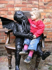 I'm sure this is nothing like having your kid sit on Santa Claus' lap. Rather this is much more disturbing since Cthulhu is pure evil. Hey, why is Cthulhu in a playground anyway?