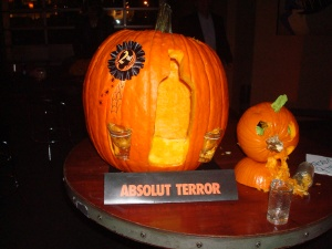Can't believe that this won second place at a pumpkin carving contest. Too bad it's bound to offend the neighbors, especially with the little pumpkin puking.