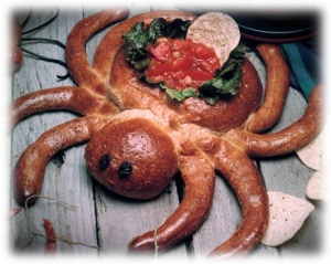 Actually the giant spider is the salsa bowl. Still, pretty scary despite being made of delicious bread.