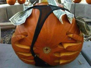 "A stripper pumpkin with a thong full of money, now I've seen everything. Still, this pumpkin display would make kids ask their parents, ""Why does this pumpkin have its underwear with money?"" I don't think they want to answer that."