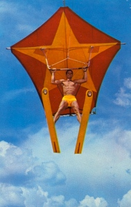 Remember kids, this man may make gliding through space on a giant kite while on water skis seem awesome but you should never try this at home ever. Still, at least he's not wearing a speedo.