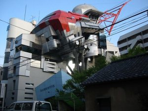 I think this building is for a technical college in Japan. Still, while the figurehead looks a mix between Speed Racer and Robocop, it's fairly fitting actually. And we're well aware that Japan has a reputation with creating robots to do more things than anyone ever thought of.