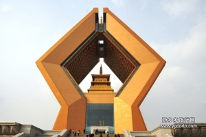 This is the Famen Temple complex area in China's Shaanxi province. Reminds me of that Oral Roberts' University sculpture with the hands praying. Yet, geometric in gold with an Asian temple between them. The real Famen Temple is actually nice want you get through this eye shore. And you'll have to deal with a crowd, being in China and all.