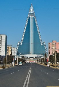 "This is the Ryugyong Hotel in Pyongyang, North Korea. It's actually not quite finished from the inside as far as I know the exterior certainly is. And the fact that North Korea is trying to promote tourism may make this building soon open for business. Still, it's nicknamed, ""the Hotel of Doom,"" and I'm not sure how such a nation with a very hostile to foreigners would want to encourage people to vacation there."