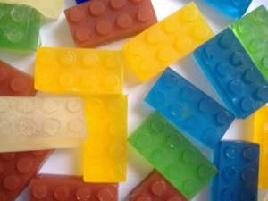 Unlike real Legos, it won't hurt you when you step on them. Well, eventually. But stepping on one of these in the shower will make you slip and perhaps fall.