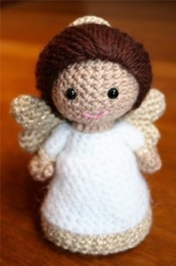 I've seen a lot of angel amigurumi on Google Images. Of course, the biggest disadvantage of having them as a tree topper is that they don't light up. Yet, that may be easily remedied.