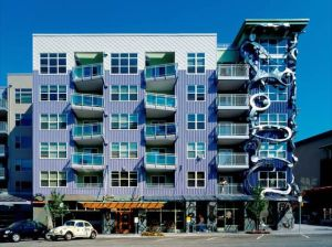 This is actually an apartment building in Seattle, Washington. And while the balconies seem to be a little askew, the right most column seems like it's being consumed by a sea monster.