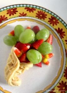 Basically this consists of green grapes, strawberries, candy corn, and a waffle to wrap it all in.