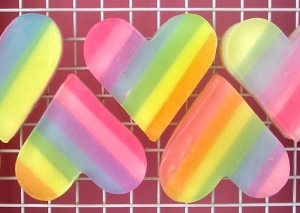 Now I don't know about you but I can't see why anybody shouldn't love rainbows, especially on hearts. Still, these are so pretty and cute. Hope they smell good, too.