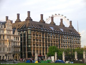 Actually it's the Portcullis House in London, which was built to provide offices for members in the UK Parliament. Yet, it seems to resemble some hideous Victorian mansion and factory complex from a Charles Dickens novel.