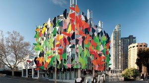 This is the Pixel building in Melbourne, Australia. It's supposed to be in an experimental style of green architecture, which is why it looks like it was designed by someone on brown acid. Nevertheless, its glass pieces can change color as well as be used for several designs.