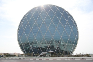 This is the Aldar Headquarters Building of Abu Dhabi, UAE. It's supposed to be the world's first circular skyscraper. Still, it may cause migraines while looking at it on a warm sunny day and resembles a fly's eye.