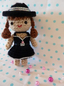 Sure she may have a crocheted dress on but still, you'd have to admit she's quite cute in that outfit and hat. And she's certainly appropriate to give to a young girl for Christmas.