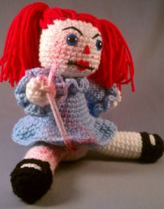Either that, or this is the love child between Raggedy Ann and Freddy Kreuger. And I hope it's the latter because I don't want to see Raggedy Ann be someone who appeared to escape Arkham Asylum.